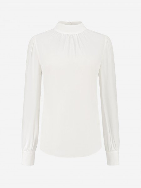 Plain white blouse with high collar