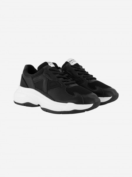 Black sneaker with white sole