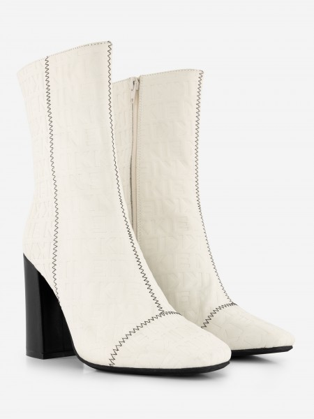 Cream leather boots with black heel
