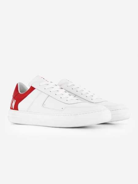 White sneaker with red back