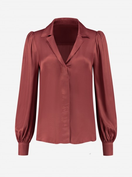 Plain shiny blouse with puffed shoulders